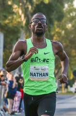 Nathan Martin, the 30-year-old from Jackson, Michigan, pulled away at the end to win the 31st edition of the race in his first time in the field. Martin won in 1 hour, 3 minutes and 36.19 seconds Sunday, beating last year's winner Tyler McCandless by 14 seconds. Going for his third win in four years, McCandless of Boulder, Colorado, couldn't keep up with Martin late in the race and finished in 1:03:50.53. third place, Ryan Smith, 24, of Auburn, Maine (1:06:09.68).