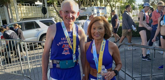 Gene Dykes (left), 71, and Jeannie Rice, 71, pose after finishing the 31st Naples Daily News Half Marathon on Sunday, Jan. 19, 2020. Dykes finished five seconds short of breaking his own American age group half-marathon record.