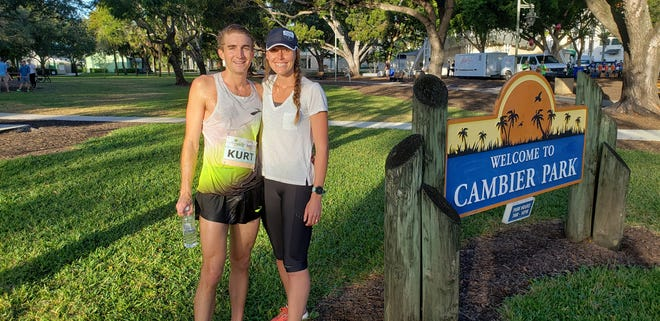 Kurt Roeser, 32, poses with his wife, Tracy, after finishing the 31st Naples Daily News Half Marathon on Sunday, Jan. 19, 2020. A Naples High School graduate, Roeser now lives in Colorado and will compete in his first U.S. Olympic marathon trials in February.