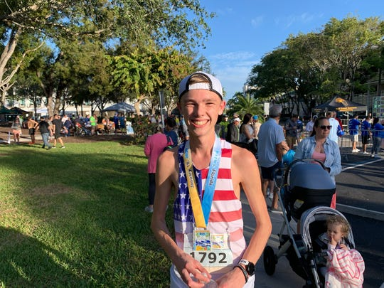 Ethan Tank, a junior at Southwest Florida Christian in Fort Myers, poses for a picture after finishing the Naples Daily News Half Marathon on Sunday, Jan. 19, 2020.
