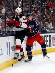 Columbus Blue Jackets forward Emil Bemstrom, right, of Sweden, checks New Jersey Devils forward Miles Wood during the first period an NHL hockey game in Columbus, Ohio, Saturday, Jan. 18, 2020.