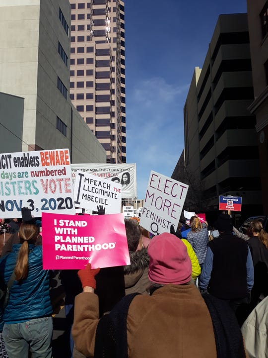"Thousands of protesters march on 3rd Street in Albuquerque as part of the fourth annual Women's March on Sunday, Jan. 19, 2020. The theme of the march was ""Women Rising."""