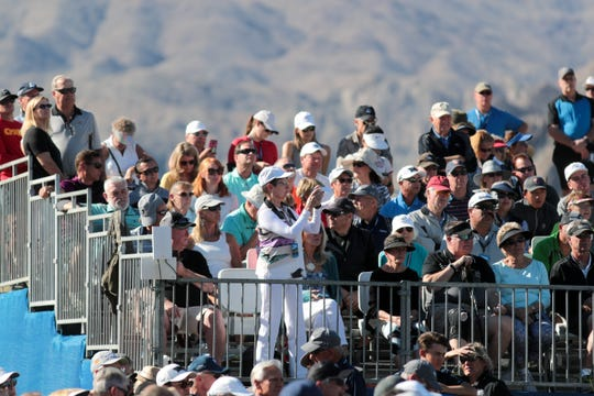 The gallery watches the action on the first hole at PGA West in La Quinta during the American Express golf tournament, January 19, 2020.