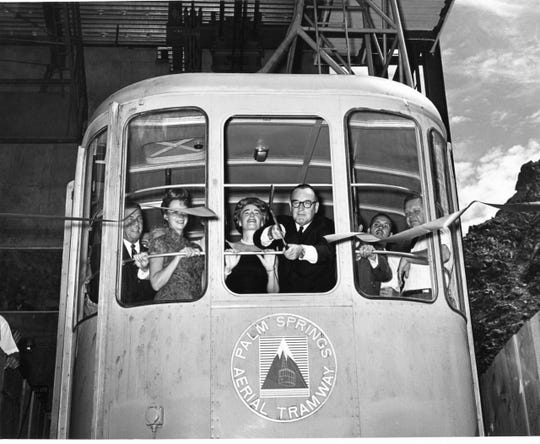 Governor and Mrs. Pat Brown in a tramcar at the ribbon cutting for the Aerial Tramway.