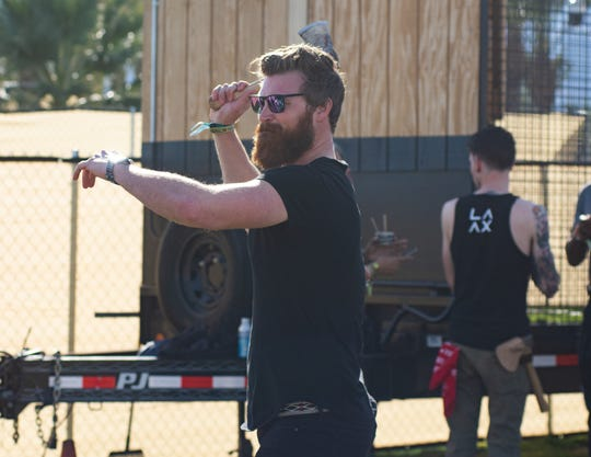 """68 Whiskey"" actor Derek Theler of Los Angeles participates in axe throwing at the 4xFar Music and Adventure Festival at Empire Grand Oasis in Thermal, Calif. on Saturday, Jan. 18, 2020."