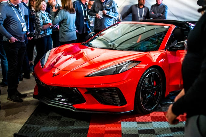 The first ever mid-engine Corvette, the 2020 Chevrolet C8 Corvette Stingray Coupe, which sold for $3 million to be donated to the Detroit Children's Fund, readies to be auctioned at the Barrett-Jackson auction in Scottsdale on Saturday, Jan. 18, 2020.