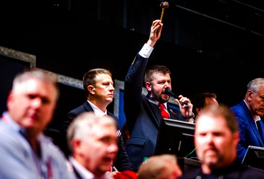 Auctioneer Joseph Mast announces auctions off a car from Paul Walker's collection at the Barrett-Jackson auction in Scottsdale on Saturday, Jan. 18, 2020.