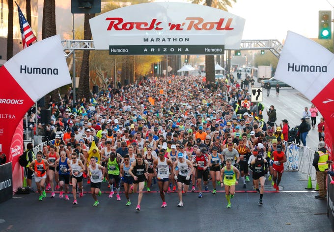 Runners start the Humana Rock 'n' Roll Marathon in downtown Phoenix on Jan.19, 2020.