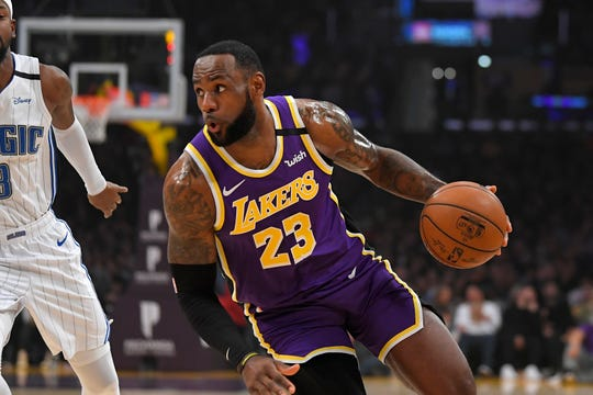 Los Angeles Lakers forward LeBron James drives toward the basket during the first half of an NBA basketball game against the Orlando Magic Wednesday, Jan. 15, 2020, in Los Angeles. (AP Photo/Mark J. Terrill)