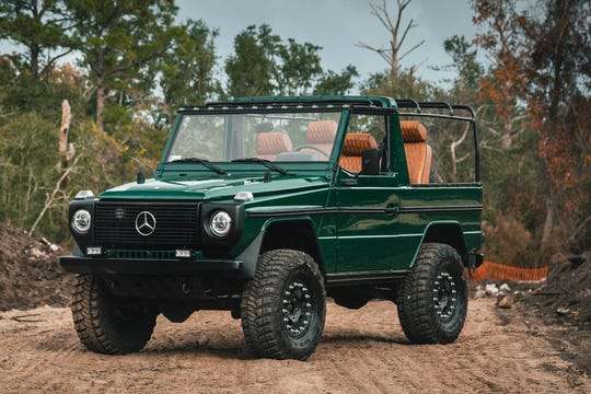 This G-Wagon was imported from Poland in 2019 and has been updated with newpaint, a custom interior, updated lights and a new bikini top.