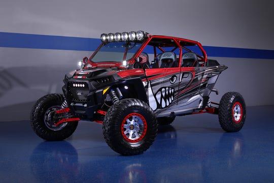 This custom ATV has custom light whips and trunk storage,KC LED lights and rock crawler lights.
