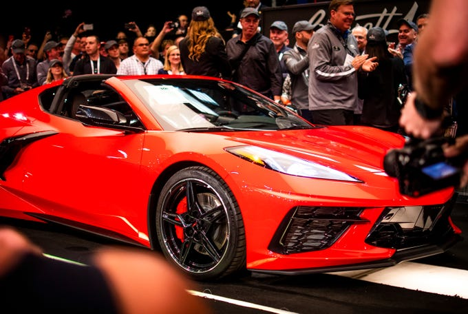The first ever mid-engine Corvette, the 2020 Chevrolet C8 Corvette Stingray Coupe, which sold for $3 million to be donated to the Detroit Children's Fund, is auctioned at the Barrett-Jackson auction in Scottsdale on Saturday, Jan. 18, 2020.