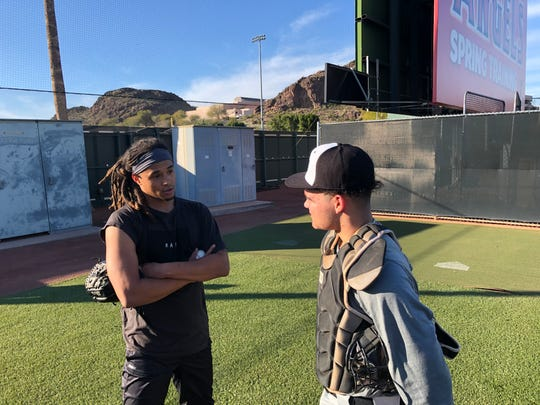 Pittsburgh Pirates pitcher Chris Archer (left) talks with Dream Series attendee Ian Moller (right) after throwing a bullpen session on Friday at Tempe Diablo Stadium.