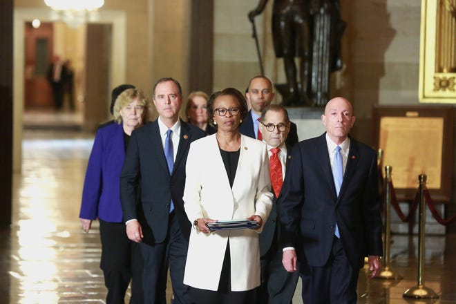 Lead by House of Representatives Clerk Cheryl Johnson and House Sergeant at Arms Paul Irving, followed by impeachment managers Rep. Adam Schiff (D-Calif.) and Rep. Jerrold Nadler (D-N.Y.), lead the procession carrying the Articles of Impeachment from the House of Representatives to the Senate on Capitol Hill in Washington, D.C., on Wednesday, Jan. 15, 2020. (Kirk McKoy/Los Angeles Times/TNS)