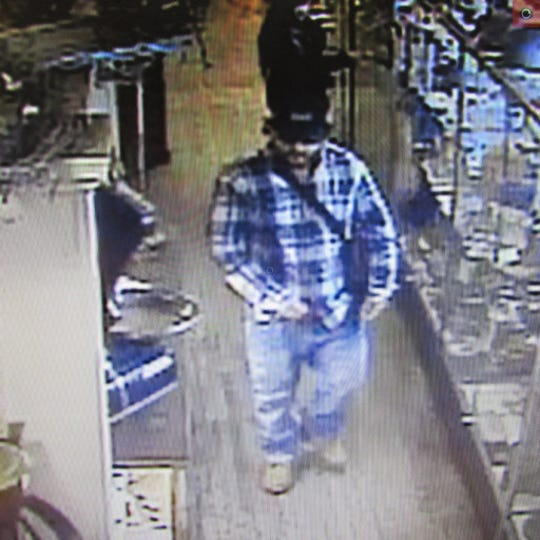 Police are looking to identify suspects in a $10,000 jewelry theft at Burning Bridge Antiques in Columbia.