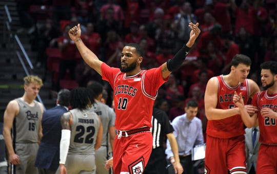 San Diego State guard KJ Feagin (10) celebrates in the second half against Nevada. The Aztecs won, 68-55, to improve to 19-0.