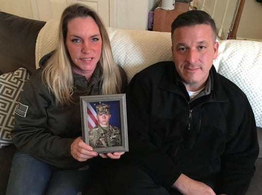 Joe and Jessica Schojan show a photo of their son, Jake Schojan, an Army paratrooper and combat engineer serving in Kuwait.