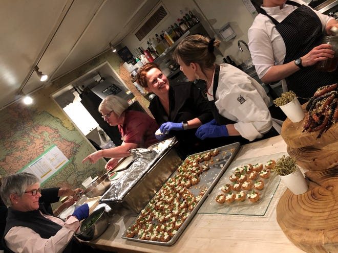 From left to right, Nancy Irelan, Susanne Messmer, Samantha Buyskes and Trish Aser work in the kitchen of the James Beard House in New York City on Jan. 18, 2020.