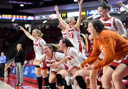 The USD women's basketball team erupts into cheers as their teammate on the court scores another three-pointer in the final minutes of their game against SDSU on Sunday, Jan. 19, at the Sanford Coyote Sports Center in Vermillion.