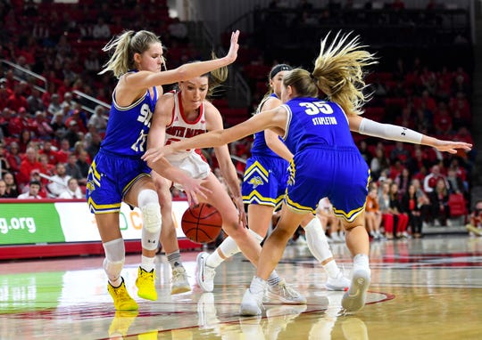 Ciara Duffy of USD fights for control of the ball amidst a tangle of SDSU arms on Sunday, Jan. 19, at the Sanford Coyote Sports Center in Vermillion.