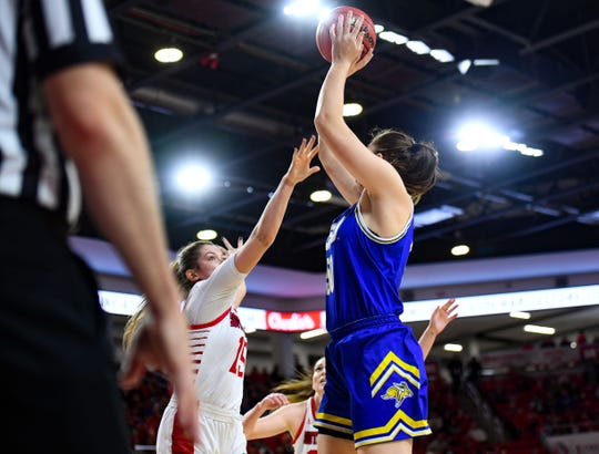 Megan Bultsma of SDSU shoots the ball while Taylor Frederick of USD tries to block her on Sunday, Jan. 19, at the Sanford Coyote Sports Center in Vermillion.