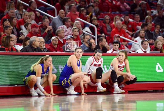 USD and SDSU women wait for their turn to enter the court on Sunday, Jan. 19, at the Sanford Coyote Sports Center in Vermillion.
