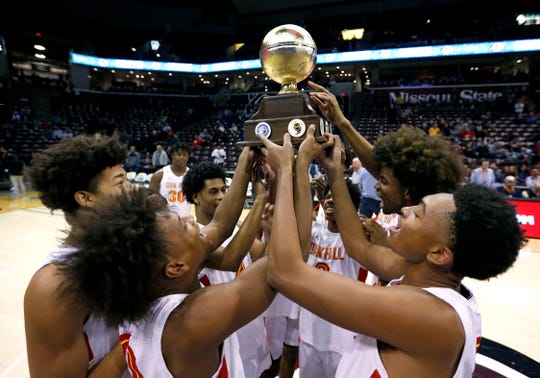 The Oak Hill Academy Warriors celebrates with the trophy after beating Paul VI to win the Bass Pro Shops Tournament of Champions at JQH Arena on Saturday, Jan. 18, 2020.