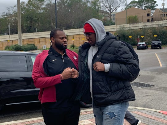 Three-star offensive tackle Robert Scott with offensive line coach Alex Atkins during his official visit to FSU.