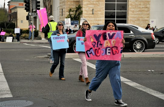 Visalia's fourth annual Women's March was held on Saturday, Jan. 18, 2020 on the corners of the Walnut Avenue and Mooney Boulevard.