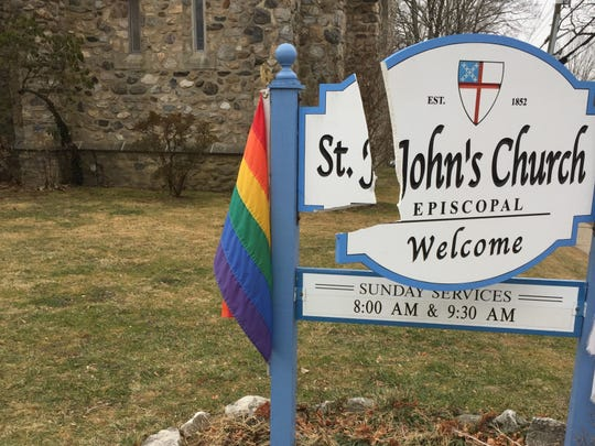 The sign at St. John's Episcopal Church in Pleasantville was damaged overnight Friday into Saturday.