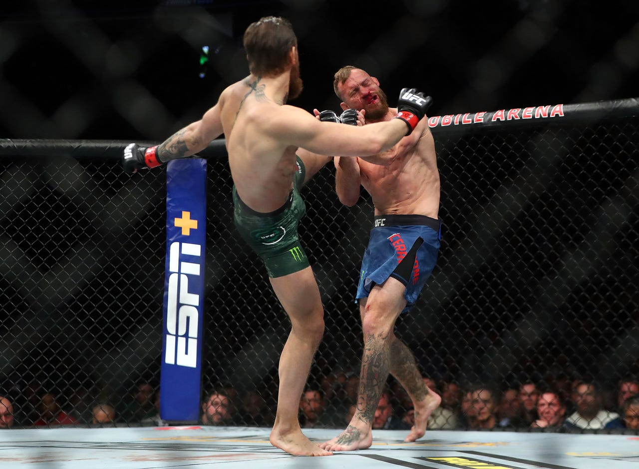 Conor McGregor lands a kick against Donald Cerrone during UFC 246 at T-Mobile Arena.