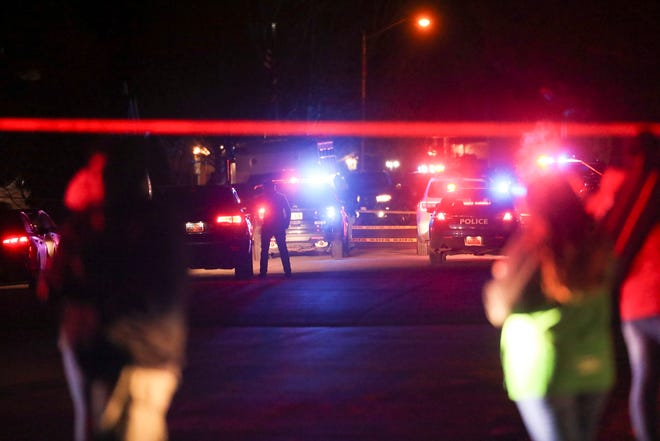 Police investigate after four people were killed and a fifth person was injured in a shooting at a Grantsville, Utah, home Friday, Jan. 17, 2020.