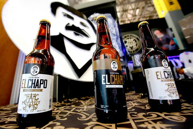 Bottles of El Chapo beer are displayed during the 72 edition of IM Intermoda Mexico fashion fair in Guadalajara, Mexico, on Jan. 14, 2020.