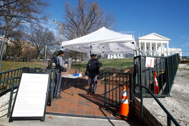 Fencing and magnetometers are set up around Capitol Square for the anticipated pro gun rally at the Virginia State Capitol Sunday, Jan. 19, 2020, in Richmond, Va.