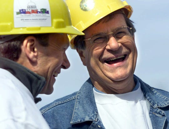 "Senate leaders Tom Daschle, left, and Trent Lott joined their colleagues in March 2001 for a Habitat for Humanities project, ""U.S. Senators Build."""