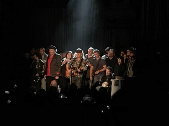 Bruce Springsteen , Bob Benjamin with musicians at the Light of Day, Jan. 18 at the Paramount Theatre in Asbury Park.