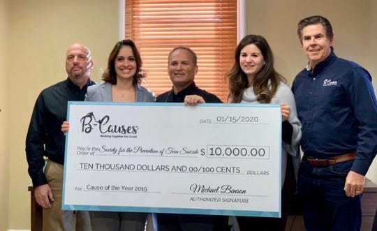 Left to Right: Bill Stavola of B-Causes, Dawn Doherty of Society for the Prevention of Teen Suicide, Michael Benson of B-Causes, Samantha Parker of Society for the Prevention of Teen Suicide and John Geantasio of B-Causes pose with a $10,000 check as a Mississippi teacher's chosen beneficiary.
