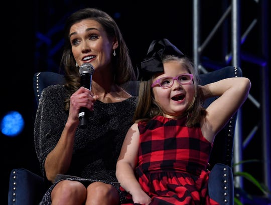 Braid Blanks and Averie Gomez share a moment as Averie and her parents, Amanda Davis and Ramey Gomez, are interviewed during Saturday's Rehab 2020 telethon at the Abilene Convention Center. Averie is a patient at the West Texas Rehabilitation Center.