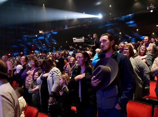 Audience members stand for the Pledge of Allegiance lead by Neal McCoy during the Rehab telethon 2020 at the Abilene Convention Center Saturday. It was the 50th year for the telethon which benefits the West Texas Rehabilitation Center.