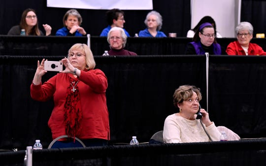 Connie Harris takes a photograph of Rehab 2020 telethon host Brad Maule as he interviews members of the phone bank during Saturday's telecast.