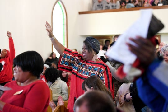 Phyllis Utley stands for a speaker during the Dr. Martin Luther King Jr. Peace March and Rally at Berry Temple United Methodist Church on Jan. 20, 2020.
