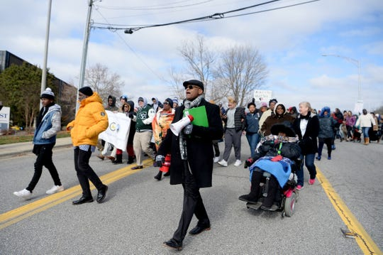 Dr. Joseph Fox, Martin Luther King, Jr. Association of Asheville and Buncombe County Vice President center leads the Dr. Martin Luther King Jr. Peace March and Rally from Berry Temple United Methodist Church to Pack Square Park on Jan. 20, 2020.