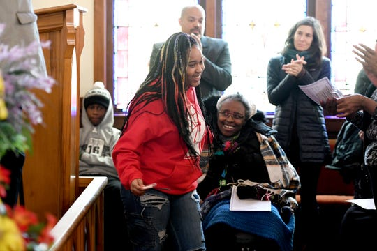 Erwin High School student Aleah Crawford is applauded after reading a poem she wrote during the Dr. Martin Luther King Jr. Peace March and Rally at Berry Temple United Methodist Church on Jan. 20, 2020.
