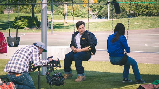 Jason Koenig (left) films a scene with Andrew Lawrence and Alexandra Rodriguez at Evergreen Rotary Park in Bremerton.