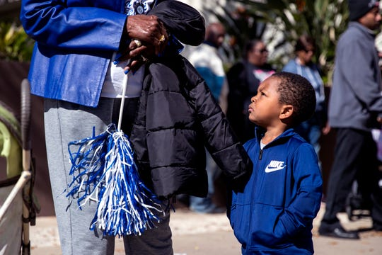 Josiah Buslett, 2, waits for the 34th annual Dr. Martin Luther King, Jr. Commemorative March to start on Monday, January 20, 2020.