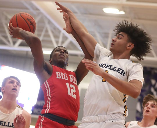 Hughes guard Camron McKenzie (12) drives to the basket against Moeller guard Aidan Turner (1) during their game at the King Classic, Sunday, Jan. 19, 2020.