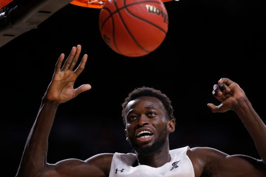 Cincinnati Bearcats forward Mamoudou Diarra (20) comes down after dunking in the second half of the NCAA American Athletic Conference basketball game between the Cincinnati Bearcats and the East Carolina Pirates at Fifth Third Arena in Cincinnati on Sunday, Jan. 19, 2020. The Bearcats tallied a conference win, 82-57, over ECU.