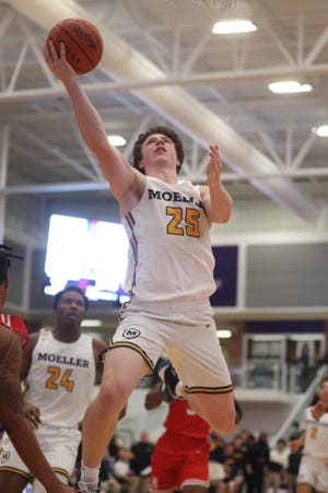 Moeller guard Micheal Currin drives to the basket during their basketball game against Hughes at the King Classic, Sunday, Jan. 19, 2020.