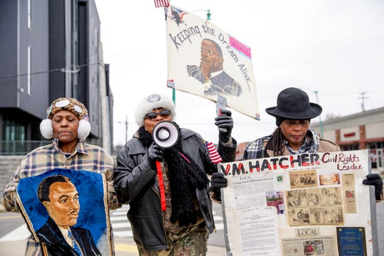 """Shirley Porter, left, Wanda Smith, center, and Diana Porter, right, march up University Ave in their own march for Martin Luther King Jr. near the intersection of University Ave and College Street in Clarksville, Tenn., on Monday, Jan. 20, 2020. Shirley has marched each year for 32 years straight, and took the day off to get out and march if her work didn't give her the day off. Wanda, a daughter of the civil rights leader Virginia Hatcher, has marched since she was a little girl. Diana, sister of Shirley, has marched for 25 years. """"King didn't stop marching for cold, rain, the police, or oppression, we aren't gonna get a little cold get in the way,"""" Smith said."""