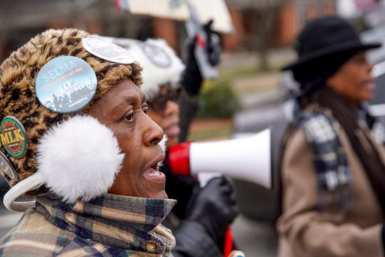 Shirley Porter, a Clarksville resident that has marched for 32 years straight, heads up University Ave near the intersection of University Ave and College Street in Clarksville, Tenn., on Monday, Jan. 20, 2020.